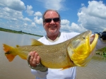 Dr. Butch Derrick with an Argentine Golden Dorado. Photo by: Dr. David Winter