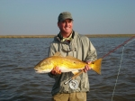 Gray Thorton with a golden Louisiana Red. Photo by: Kelli Thorton