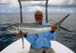 Dr. George Toledo with a Seychelles Milkfish. Photo courtesy of Dr. Toledo