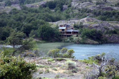 A view of Skip Mullen's lodge from across the lake. Photo by: Brent Boone