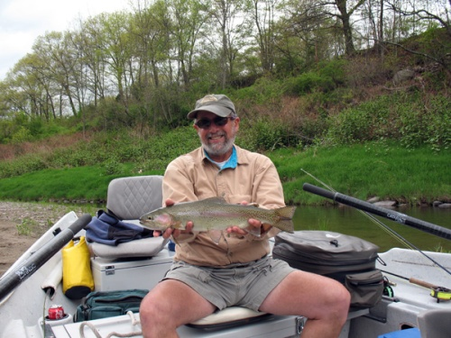 Bruce Miller with a great rainbow caught on his birthday. Photo by: Bart Larmouth