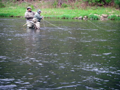 Stevie Shen guides Dennis Burns. All those spots on the water? BUGS!!!! Photo by: John Middleton